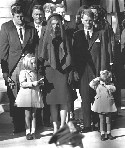 Jacqueline Kennedy stands with her two children Ca