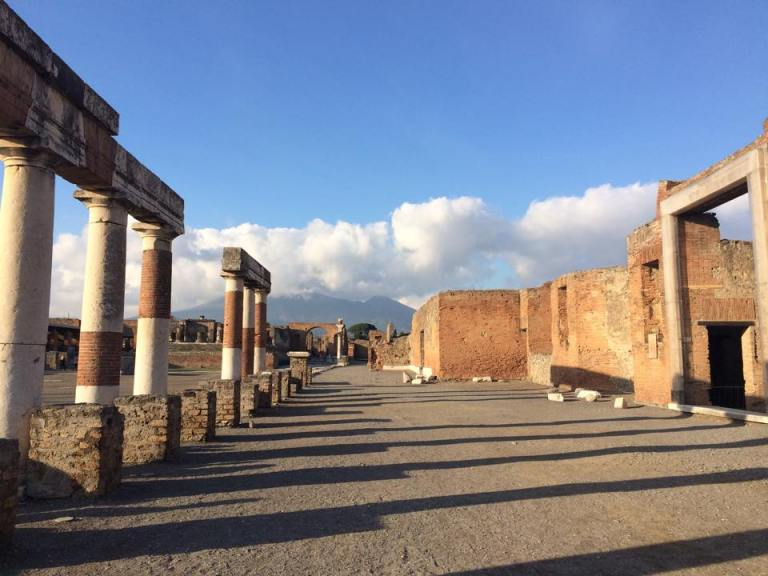 The city center of Pompeii with Vesuvius pictured in the background.