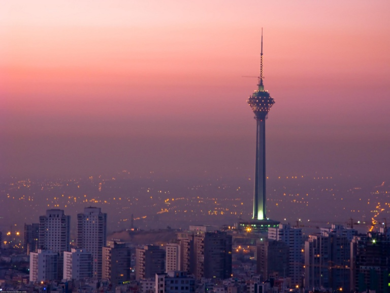 Tehran skyline at sunrise, featuring the Milad Tower. Photo courtesy of Flickr user Afshin Rattansi.